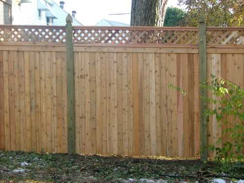 Close board diamond trellis fencing with wooden posts